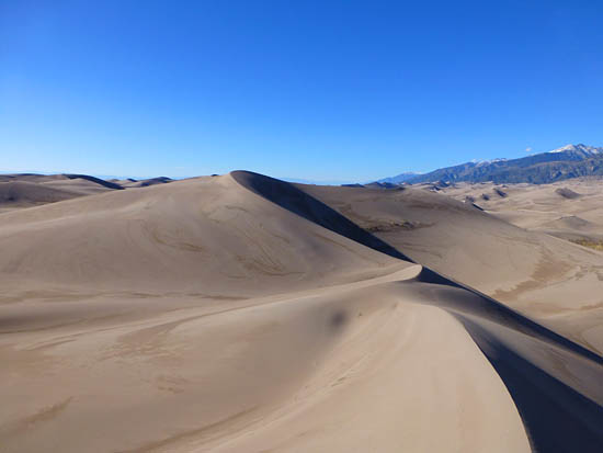The tallest dunes form on the east side of the dunefield over Medano Creek